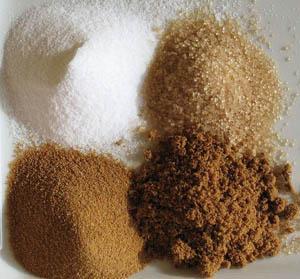 From Top Left Corner, Clockwise. White Sugar, Raw Sugar, Fine Brown Sugar, Rapadura